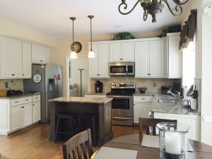 By using the existing kitchen cabinet boxes, Kitchen Solutions was able to give this kitchen a complete facelift in five days, including new cabinet door and drawer fronts, decorative trim, a newly painted cabinet finish, and  a completely redesigned kitchen island.
